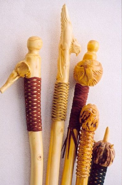 Walking Sticks With A Burl Head And Leather Handle Grips